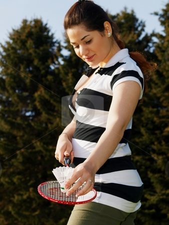 Woman badminton stock photo, A woman is holding a badminton racket and a shuttlecock by Arve Bettum