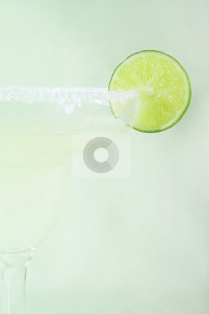 Margarita stock photo, Closeup of Margarita drink with slice of lime, very subtle blend with the green background by iodrakon
