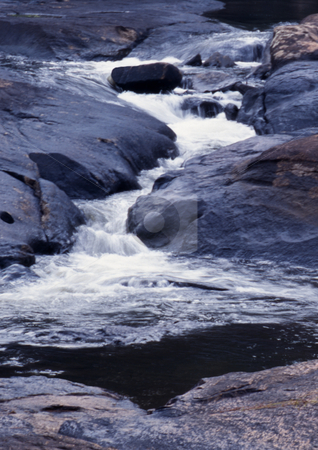 Stream Falls stock photo, Small stream cascading between two rock formations by Roger Otto