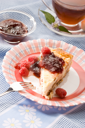 Cheese-cake stock photo, Food series:  cheese-cake with red raspberry jam by Gennady Kravetsky