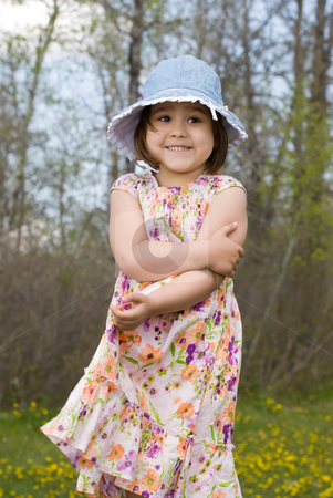 Child Outside Wearing Summer Dress stock photo, Four year old girl smiling, while wearing a summer dress and enjoying the outside air by Richard Nelson