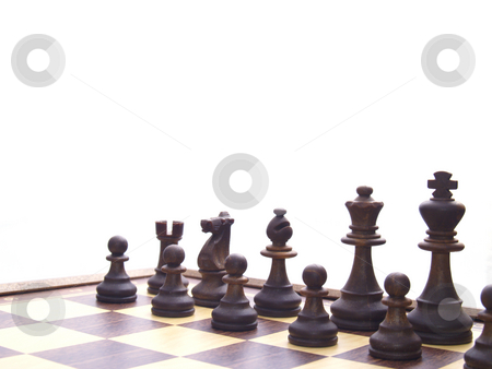 Chess board stock photo, Black chessmen on chess board in the beginning of game by Torsten Lorenz