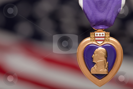 Purple Heart Against Americal Flag stock photo, Purple Heart Against a Blurry Americal Flag. by Andy Dean