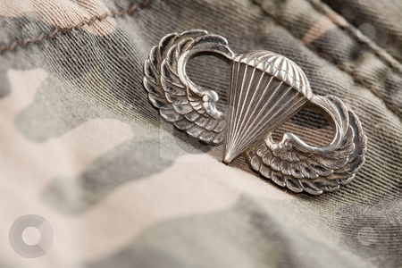 Paratrooper War Medal stock photo, Paratrooper War Medal on a Camouflage Material. by Andy Dean