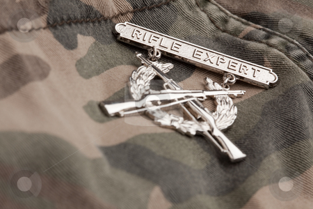 Rifle Expert War Medal stock photo, Rifle Expert War Medal on a Camouflage Material. by Andy Dean