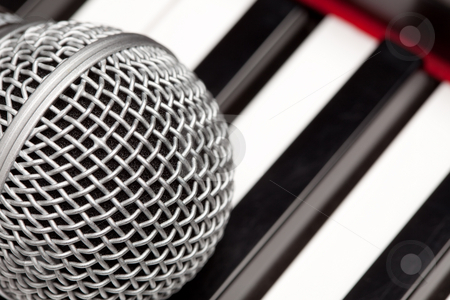 Microphone Laying on Electronic Keyboard stock photo, Microphone Laying on Electronic Keyboard with Narrow Depth of Field. by Andy Dean