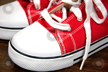 Closeup of Classic Red Sneakers stock photo, This closeup is a photo of classic red sneaker shoes. by Valerie Garner