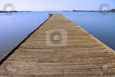 Lake landscape stock photo, Old wooden pier on Palic lake in Serbia by Julija Sapic