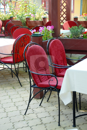 Restaurant terrace stock photo, Restaurant terrace with metallic chairs and tables outdoor by Julija Sapic