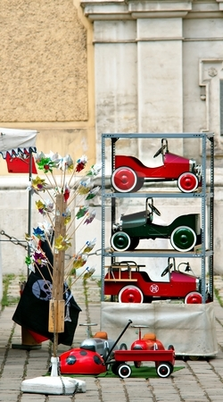 Toys wooden cars stock photo, Toys cars in green and red on a flee market by Juraj Kovacik