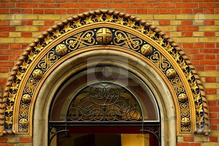 Ornamental window detail stock photo, Ornamental window detail with red yellow bricks by Juraj Kovacik