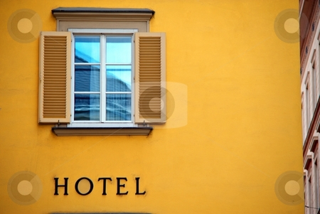 Hotel sign stock photo, Hotel sign with blue window and yellow facade by Juraj Kovacik