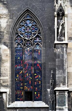 Gothic window stainglass stock photo, Gothic window detail with modern stainglass by Juraj Kovacik