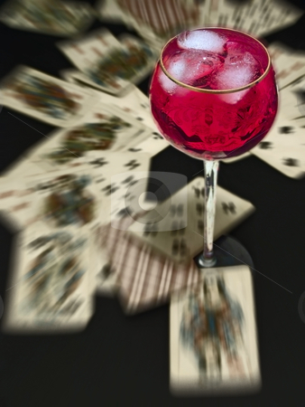 Illusion cards stock photo, Wineglass with the red wine on the table with heap of plaing cards by Sergej Razvodovskij