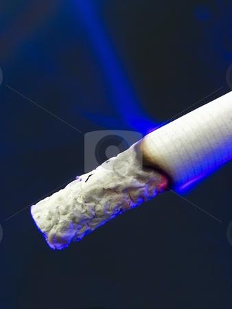 Night cigarette stock photo, The night cigarette with blue light by Sergej Razvodovskij