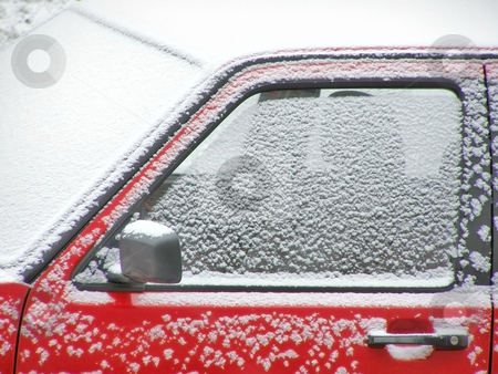 Red snow car stock photo, Red car under snow by Sergej Razvodovskij