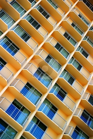 Scratchy Hotel Facade stock photo, Facade of a tall yellow hotel building. by Henrik Lehnerer