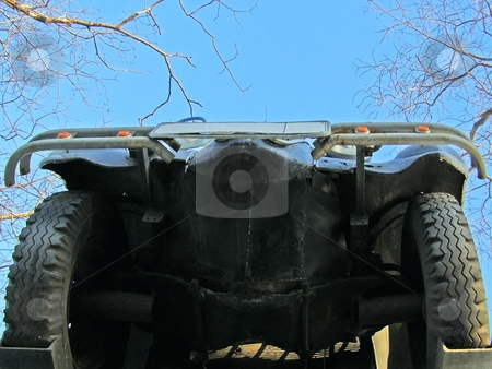 Underneath of car stock photo, Underneath of the car against blue sky by Sergej Razvodovskij