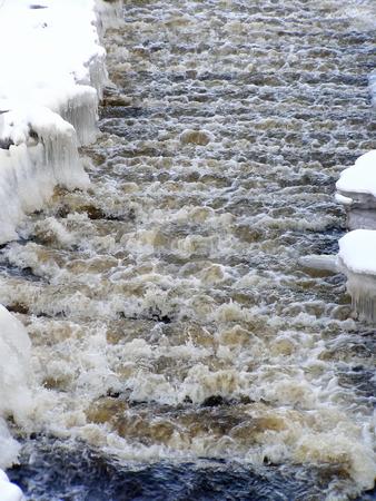 Winter stream with snow stock photo, Stream of water run through the white snow by Sergej Razvodovskij