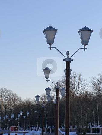 Row of lanterns stock photo, The row of the town lanterns winter season by Sergej Razvodovskij