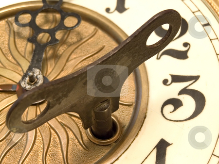 Close up clock stock photo, Old fashioned close up clock with the key by Sergej Razvodovskij