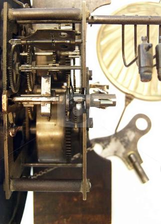 Clock mechanism stock photo, Mechanism of the old broken wall clock by Sergej Razvodovskij