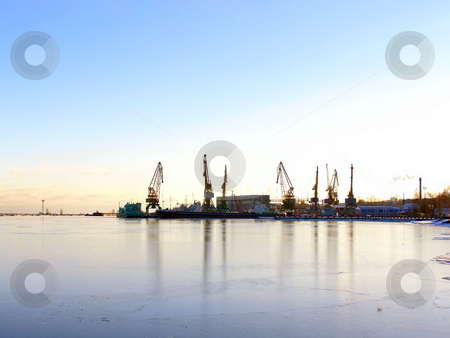 Winter port stock photo, Winter cargo side port with ships and cranes by Sergej Razvodovskij
