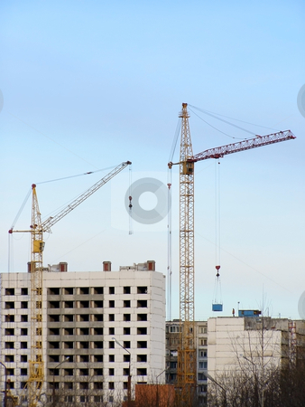 Buildings and cranes stock photo, Buildings and cranes in the growth part of town by Sergej Razvodovskij
