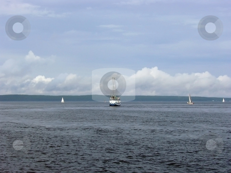 Clouds and yachts stock photo, Yachts against the coastline with the clouds by Sergej Razvodovskij