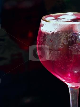 Wineglass stock photo, Half of wineglass full of red wine with ice by Sergej Razvodovskij