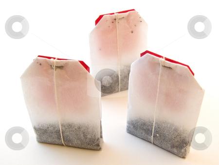 Tea bags stock photo, Three tea bags against the white background by Sergej Razvodovskij