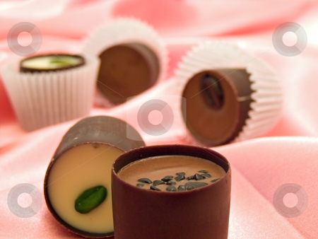 Sweets at the silk stock photo, Different chocolate sweets at the pink silk by Sergej Razvodovskij