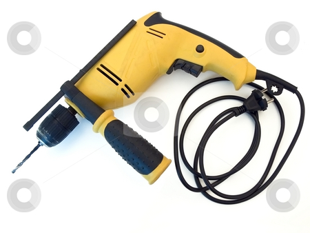 Drill stock photo, Single unplugged yellow electrical drill at the white table by Sergej Razvodovskij