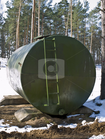 Barrel stock photo, Big green barrel with staircase in the forest by Sergej Razvodovskij