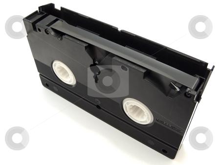 Video tape stock photo, Black video tape against the white background by Sergej Razvodovskij