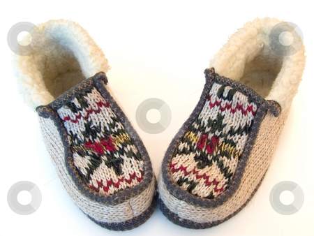 Knitted slippers stock photo, The budge hand made knitted slipperswith ornate by Sergej Razvodovskij
