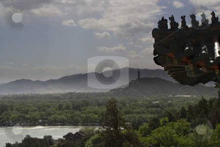 Roof of the Summer Palace, Yiheyuan, Beijing, China with Pagoda  stock photo, Roof of the Summer Palace on a blue day, Beijing, China with pagoda in the background by William Perry