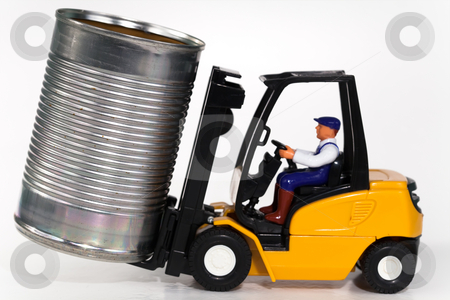 Forklift and tin can stock photo, A toy forklift truck lifting a tin can. by Norma Cornes