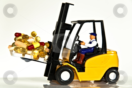 Fork lift and tablets stock photo, A toy fork lift truck lifting a pallet full of drugs or tablets by Norma Cornes