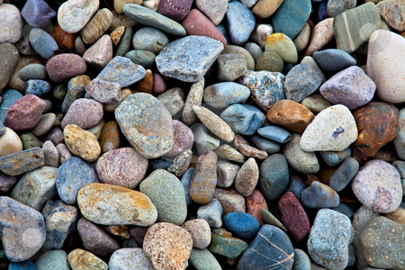 Stones stock photo, Pebbles and stones lying on a beach. A great background. by Norma Cornes