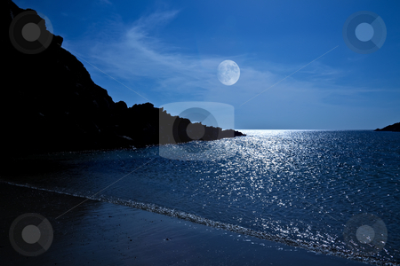 Moonlight Bay stock photo, The rising moon reflected in the ocean from a beautiful bay by Norma Cornes