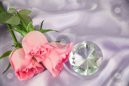 Rosebuds and diamond stock photo, Three pink rosebuds and a diamond lying on lilac satin by Norma Cornes