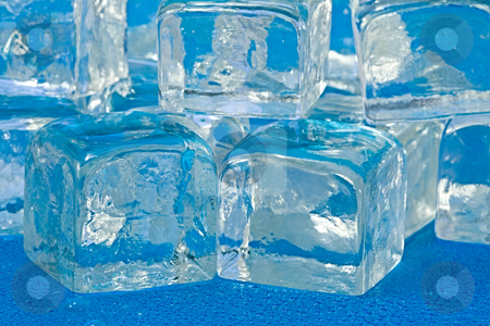 Ice cubes stock photo, Stacked up ice cubes slowly melting by Norma Cornes