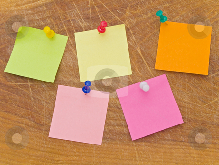 Stickers and notes at the drowing pins stock photo, Multicolored stickers and notes and drowing pins at the wooden board by Sergej Razvodovskij