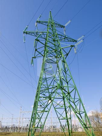 Single electricity tower stock photo, Single electricity tower against the blue sky by Sergej Razvodovskij