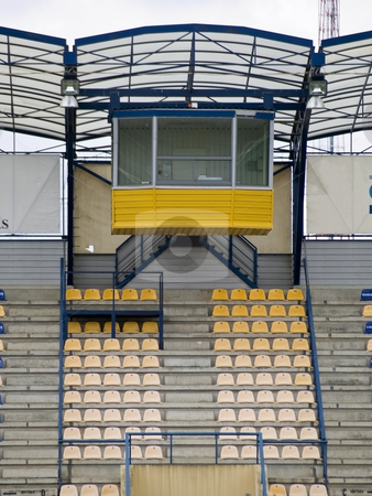 Stadium cabine stock photo, Stadium empty cabine and the rows of the yellow seats by Sergej Razvodovskij
