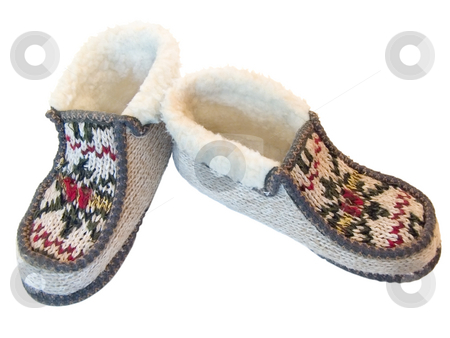 Home slippers stock photo, The budge hand made knitted slipperswith ornate by Sergej Razvodovskij