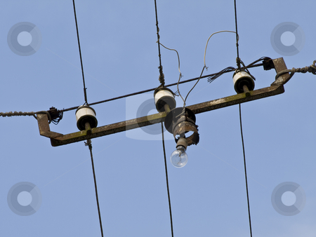 Street wires with lamp stock photo, Street wires with lamp against blue sky by Sergej Razvodovskij