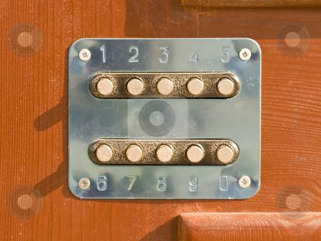 Code key stock photo, Code key lock at the wood brown door by Sergej Razvodovskij