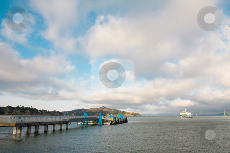 Cruise Ship And Port Seascape stock photo, A cruise ship is approaching a port. A beautiful cloudy blue sky. by Hieng Ling Tie